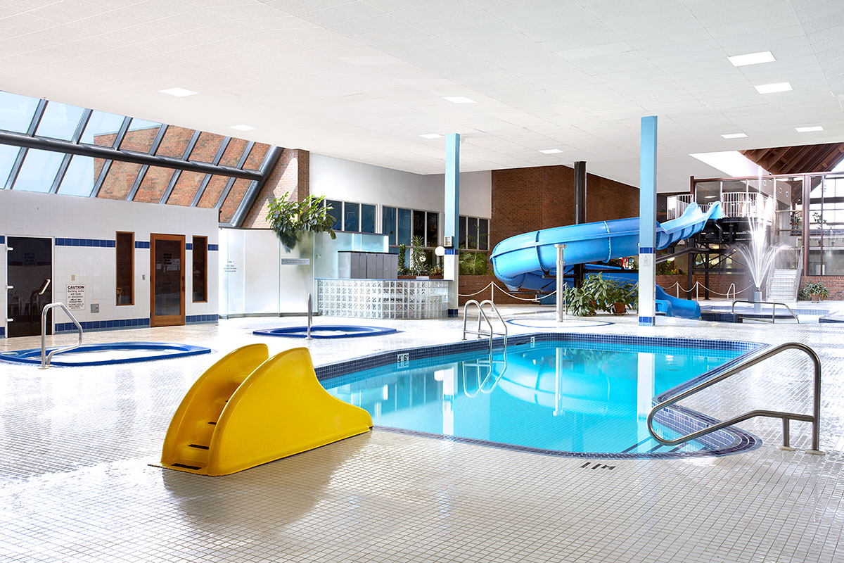 Indoor pool with waterslide  Ambassador Kingston | Hotel & Conference Centre - Waterpark